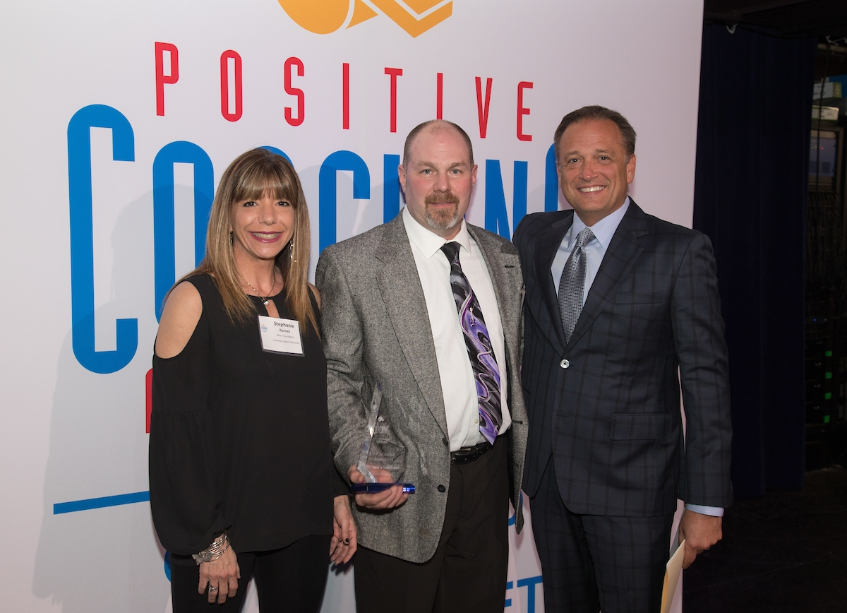 Luminary Award Recipients, Stephanie and Scott Kornet, with event emcee and FOX SportsTime Ohio broadcaster, Matt Underwood