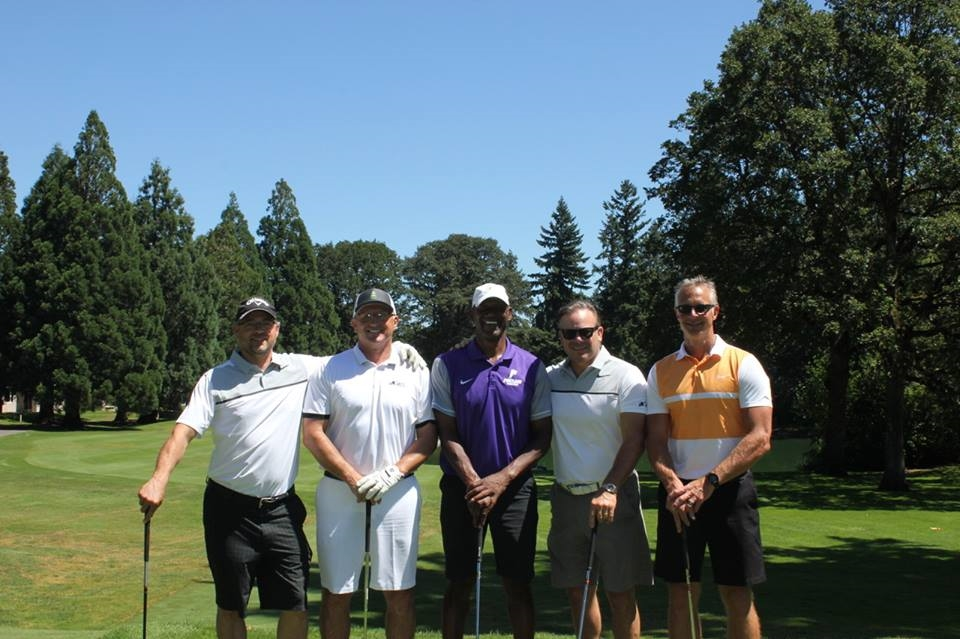 Portland Pilots Head Basketball Coach with his foursome